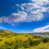 California meadows hill and lake in a blue sky spring — Stock Photo