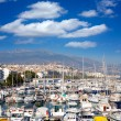 Foto Stock: Altevillage in alicante with marinboats foreground