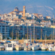 Stockfoto: Altevillage in alicante with marinboats foreground