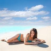Asian brunette girl lying on the summer beach white sand — Stock Photo