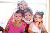 Sister and friends kid girls in hug happy together — Stock Photo