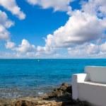 Torrevieja Alicante white bench in the shore rocks — Stock Photo