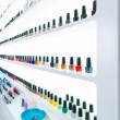 Stock Photo: Colorful nail polish colors in a row at nails saloon on white