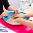 Nail saloon scrub bath exfoliant hands in bowl water — Stock Photo #40198083