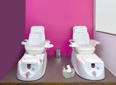 Nail saloon Pedicure chair spa furniture in pink wall — Stock Photo