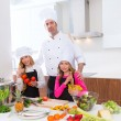 Chef master and junior pupil kid girls at cooking school — Stock Photo #41036309