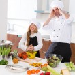 Funny chef master and junior kid girl at cooking school crazy — Stock Photo #41036591