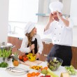 Funny chef master and junior kid girl at cooking school crazy — Stock Photo #41036755