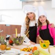 Kid girls junior chef friends hug together at cooking school — Stock Photo #41038259