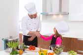 Chef master and junior pupil kid girl handshake — Stock Photo