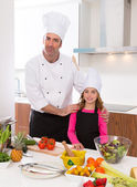 Chef master and junior pupil kid girl at cooking school — Stock Photo