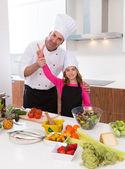 Junior chef beautiful girl and master teacher award winner — Stock Photo