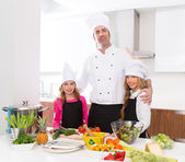 Chef master and junior pupil kid girls at cooking school — ストック写真
