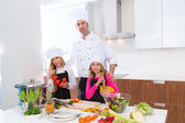 Chef master and junior pupil kid girls at cooking school — Stockfoto