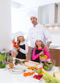 Chef master and junior pupil kid girls at cooking school — Stock Photo