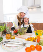 Kid girls junior chef friends hug together in countertop — Stock Photo