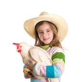 Blond kid girl farmer holding white hen on arms — Stock Photo