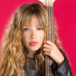 Blond Rock and roll girl with bass guitar on red — Stock Photo #41041571