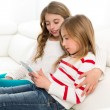 Children sister friends kid girls playing together with tablet p — Stock Photo