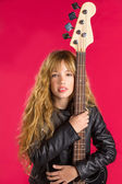 Blond Rock and roll girl with bass guitar on red — Stock Photo