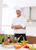 Chef male portrait on white countertop at kitchen — Stock Photo