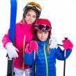 Siters kid girls with ski poles helmet and snow goggles — Stock Photo #41768529