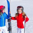 Kid girls sister in winter snow with ski equipment — Stock Photo