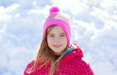 Blond kid girl winter hat in the snow smiling — Stock Photo