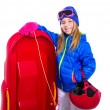 Blond kid girl with red sled snow equipment helmet and goggles — Stok fotoğraf