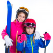 Siters kid girls with ski poles helmet and snow goggles — Stock Photo #41770793