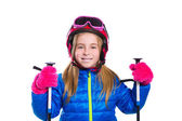 Blond kid girl happy going to snow with ski poles and helmet — Photo