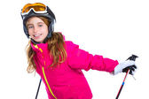 Kid girl with ski poles helmet and goggles smiling on white — Stock Photo
