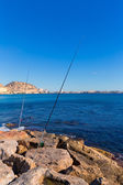Alicante and san Juan fishing in breakwater at Spain — Stock Photo