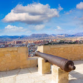 Alicante skyline and old canyons of Santa Barbara Castle — Stock Photo