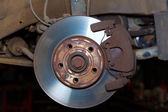 Car wheel brake rusty disc with pads rotor disc and caliper — Stock Photo