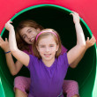 Kid sister girls playing in the park playground — Stock Photo