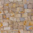 Masonry wall textre of handmade stones traditional style — Stockfoto