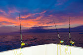 Boat fishing trolling at sunset with rods and reels — Stock Photo