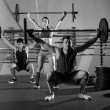 Barbell weight lifting group workout exercise gym — Stock Photo #44275817
