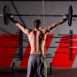 Barbell weight lifting man rear view workout gym — Stock Photo #44277447
