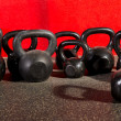 Kettlebells weights in a workout gym — Stock Photo