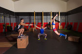 Gym group workout barbells slam balls and jump — Stock Photo