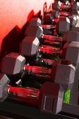Hex Dumbbells weight training equipment gym — Stock Photo