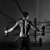 Hex dumbbells man workout rear view at gym — Stock Photo