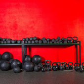 Kettlebell  dumbbell and weighted balls at gym — Foto Stock