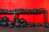 Kettlebell  dumbbell and weighted balls at gym — Stock Photo