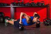 Kettlebells push-up man strength gym workout — Stock Photo