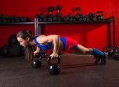 Kettlebells push-up woman strength gym workout — Stok fotoğraf