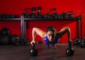 Kettlebells push-up woman strength gym workout — Stock Photo