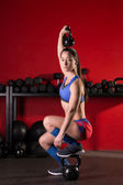 Kettlebell lifting woman workout in red gym — Foto de Stock